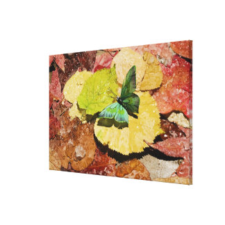 Butterfly on wet autumn leafs canvas print