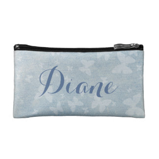 Butterfly pattern on faded denim look cosmetic bag