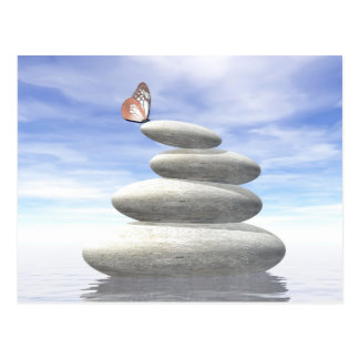 Butterfly upon balanced stones postcard