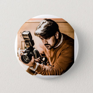 Button with a photographer