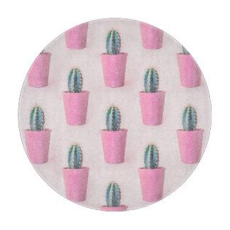 Cacuts in pink pot cutting board