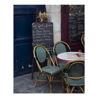 Cafe table with cane chairs in Paris, France Poster