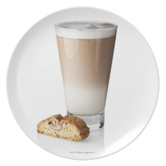 Caffe latte with biscotti, on white background, dinner plate