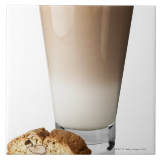 Caffe latte with biscotti, on white background, large square tile