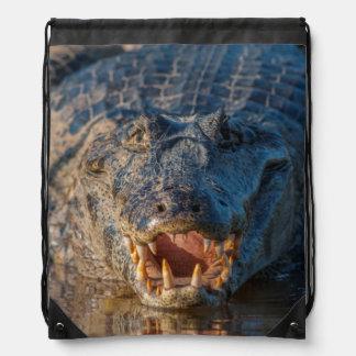 Caiman shows its teeth, Brazil Drawstring Bag