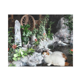Calico Cat In The Garden Stretched Canvas Print