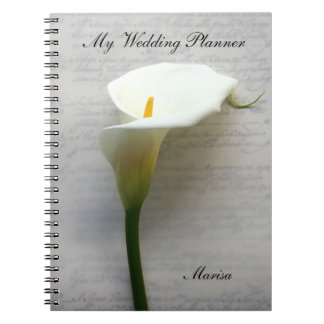 Calla lily on old handwriting spiral notebook
