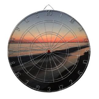 Calm morning beach sunrise dartboard