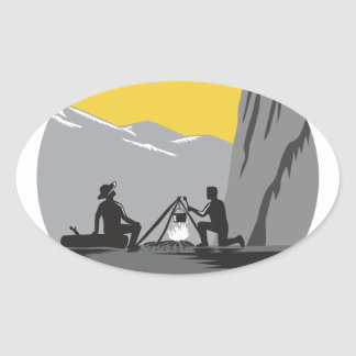 Campers Sitting Cooking Campfire Circle Woodcut Oval Sticker