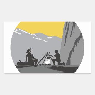 Campers Sitting Cooking Campfire Circle Woodcut Rectangular Sticker