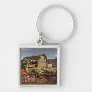 CANADA, British Columbia, Enderby. Log Barn Silver-Colored Square Key Ring