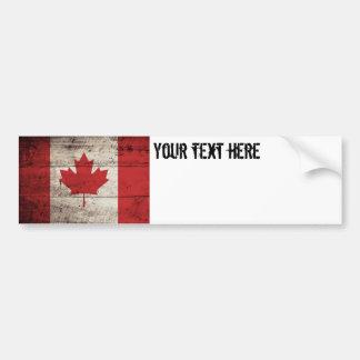 Canada Flag on Old Wood Grain Bumper Sticker