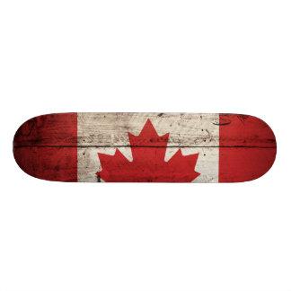 Canada Flag on Old Wood Grain Skate Deck
