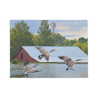 Canada Geese Landing On The Pond Doormat