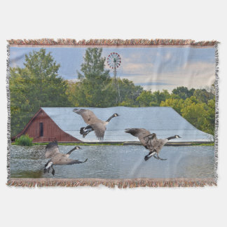 Canada Geese Landing On The Pond Throw Blanket