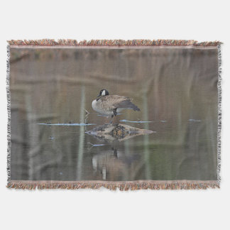 Canada goose takes a nap throw blanket