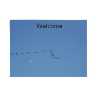 Canadian geese in flight doormat