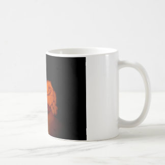 Candle, hands, flame, wood. coffee mug