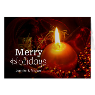 candle on red greeting card