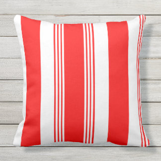 Candy striped outdoor throw pillow in cardinal red