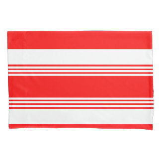 Candy striped reversible bed pillows in red pillowcase