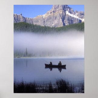 Canoe fishing Waterfowl Lake, Banff National Poster