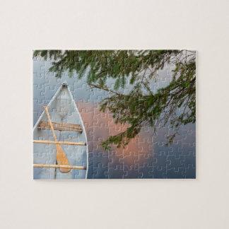 Canoe on lake at sunset, Canada Jigsaw Puzzle
