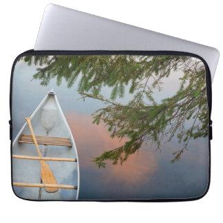 Canoe on lake at sunset, Canada Laptop Sleeve