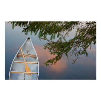 Canoe on lake at sunset, Canada Poster