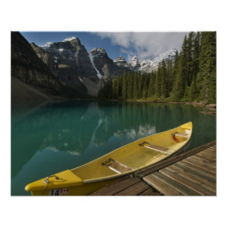 Canoe parked at a dock along Moraine Lake, Banff Poster