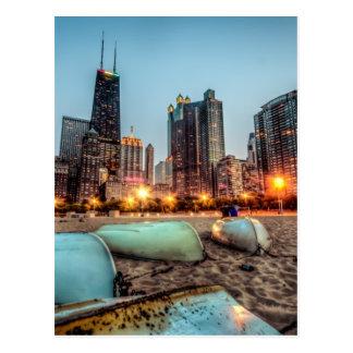 Canoes on Oak Street Beach a little after sunset Postcard