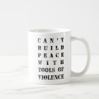 Can't build peace with tools of violence (darker) basic white mug