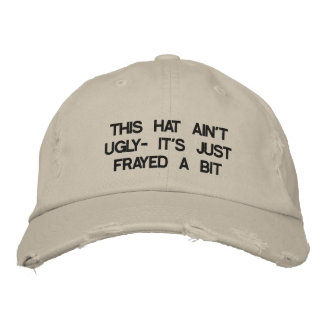 Cap with saying on it. baseball cap