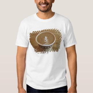 Cappuccino with tree design in foam tee shirts