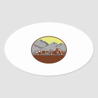 Car being towed Away Mountains Oval Woodcut Oval Sticker