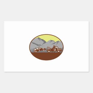 Car being towed Away Mountains Oval Woodcut Rectangular Sticker
