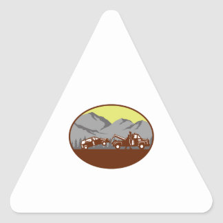 Car being towed Away Mountains Oval Woodcut Triangle Sticker