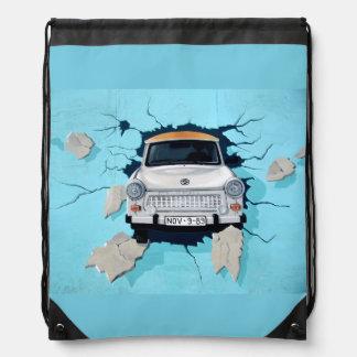Car crosses a wall drawstring bag