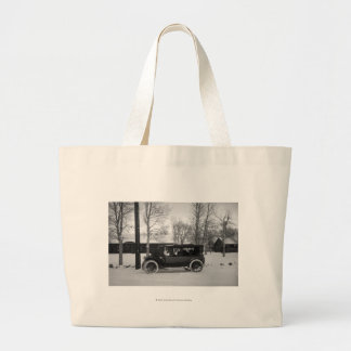 Car with Christmas tree tied on the hood Canvas Bag