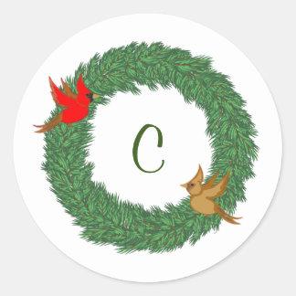 Cardinals in Evergreen Wreath with Monogram Classic Round Sticker