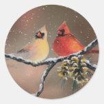 CARDINALS in the SNOW by SHARON SHARPE Round Sticker