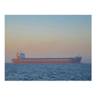 Cargo Ship In A Hazy Dusk Postcard