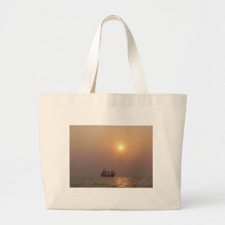Cargo Ship Under A Hazy Sun Canvas Bags
