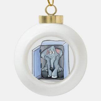 Cartoon elephant sitting inside a refrigerator ceramic ball christmas ornament
