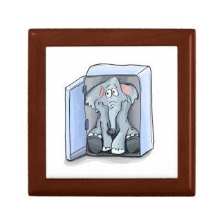 Cartoon elephant sitting inside a refrigerator gift box