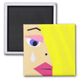 Cartoon female face with tear magnet