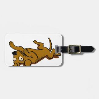 Cartoon happy dog is lying down luggage tag
