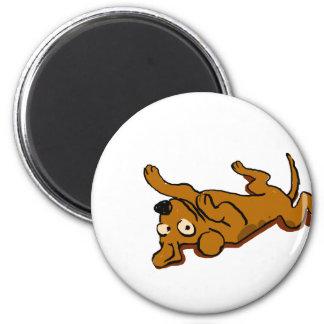 Cartoon happy dog is lying down magnet