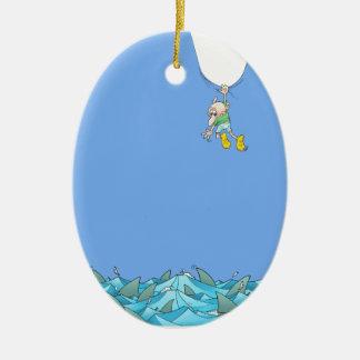 Cartoon illustration of a man hanging over sharks. ceramic oval decoration