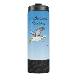 Cartoon seagull flying over head with a blue sky thermal tumbler
